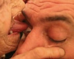 Elderly Woman Licks Eyeballs Clean For Living